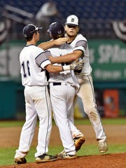 Dallastown's Zach Ness, left, and Michael Carr, right, greet pitcher Alex Weakland after Pennsbury's walk-off win in the seventh inning of the PIAA Class 6A baseball title game Friday, June 16, 2017, at Medlar Field at Lubrano Park in State College. After a 3.5-hour rain delay and despite outhitting Pennsbury 7-4, Dallastown lost 1-0 in Pennsbury's walk-off win in the seventh inning.