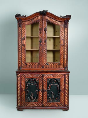"""This is a bookshelf and cabinet made for a house furnished in Adirondack or Rustic style. It is 86 inches high and 46 inches wide. The chest is signed """"DZ JR"""" in the wood. Its price is $6,150."""