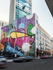 A Hense mural on the side of the Madison building at