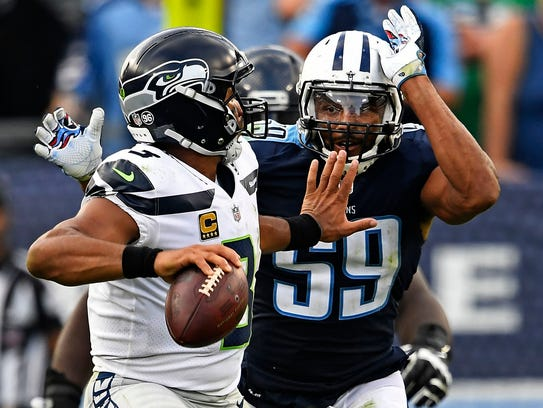 Seahawks quarterback Russell Wilson (3) faces pressure