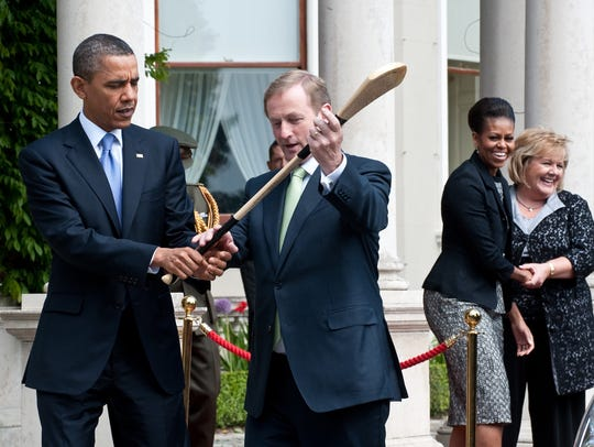 Irish Prime Minister Enda Kenny shows Then-President