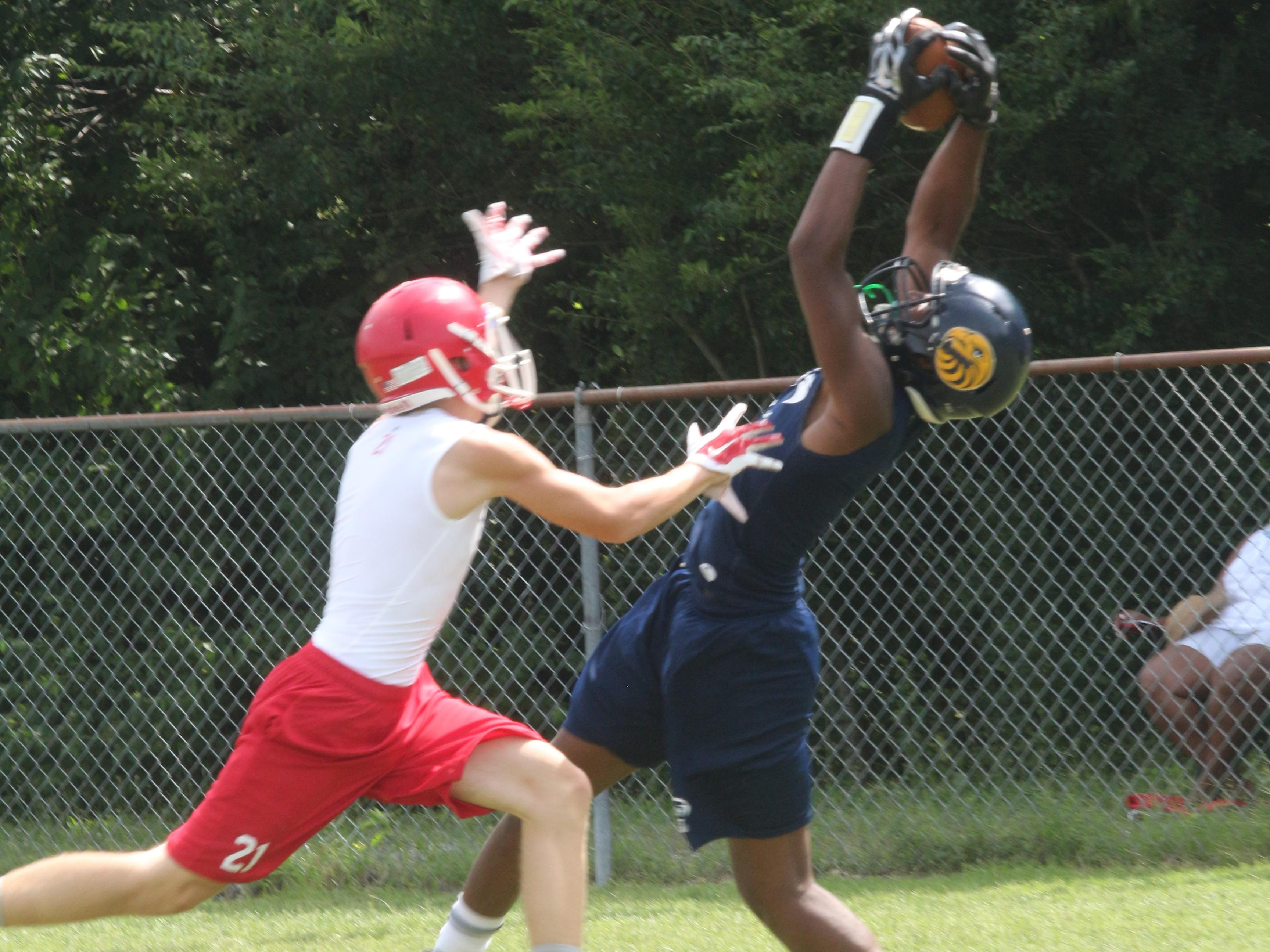 Northeast wideout William Wilcox snags a pass from quarterback Benji Burchwell against Montgomery Central during the tournament portion of the National Select 7-on-7 competition Thursday at Clarksville High School.