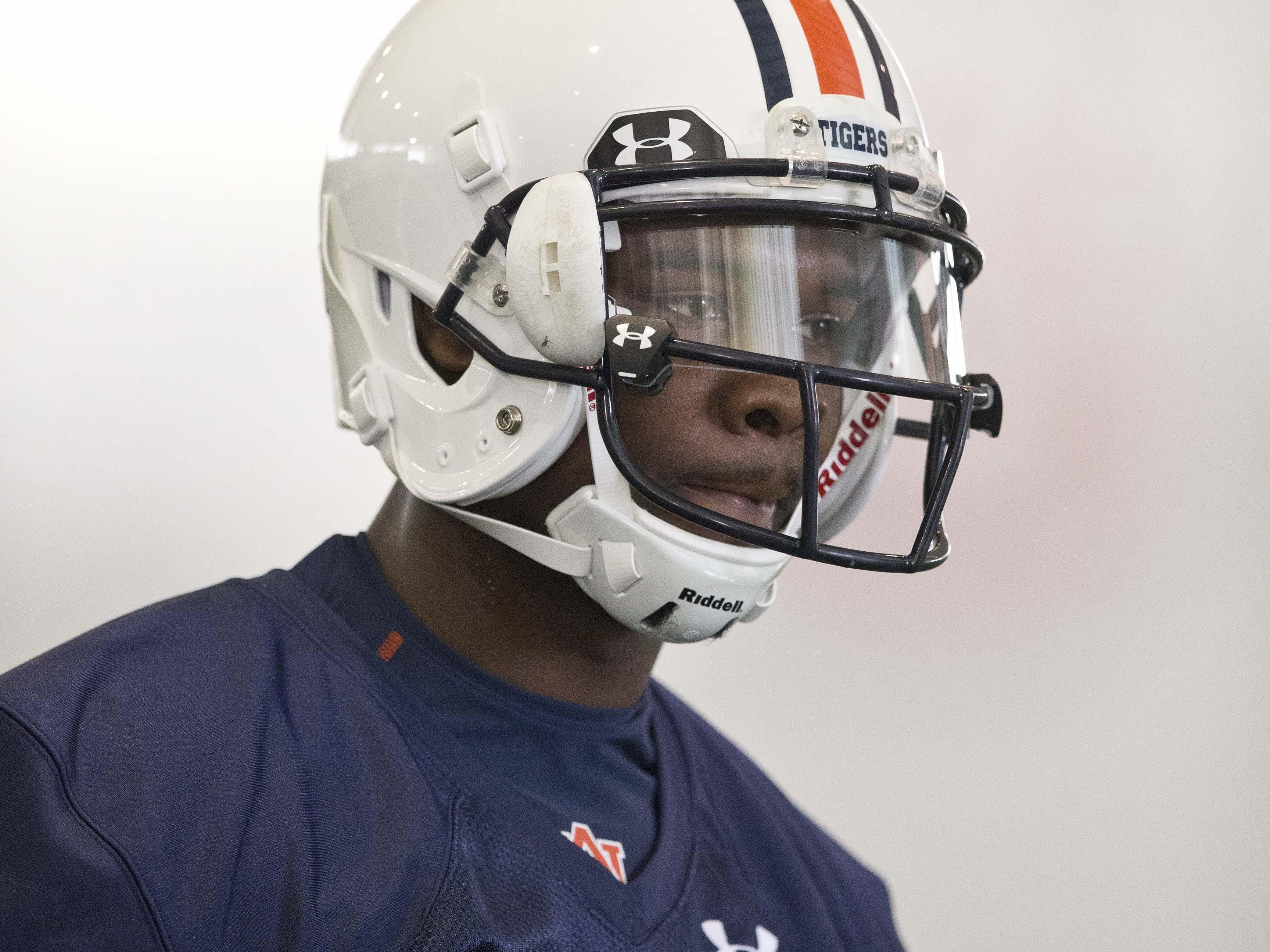 Auburn wide receiver D'haquille Williams looks to a coach for drill instructions during an NCAA college football practice, Tuesday, Aug. 4, 2015, in Auburn, Ala. (AP Photo/Brynn Anderson)