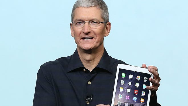 Apple CEO Tim Cook holds the new iPad Air 2 during a special event on Oct. 16, 2014, in Cupertino, Calif.