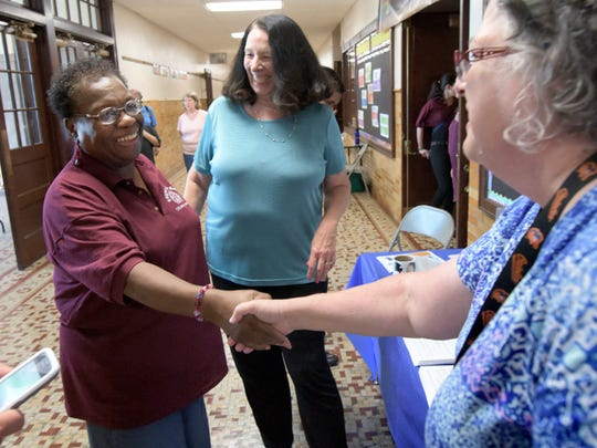 York City School Board President Margie Orr, left, is introduced to Jackie Dell-Shearer, Martin Library after school program manager, by Paula Gilbert, center, the library's director of youth services, during a tour Edgar Fahs Smith STEAM Academy Wednesday, Aug. 9, 2017. The school will be open for classes starting Monday, Aug. 21, for students in grades 3-8 for the new school year. Bill Kalina photo