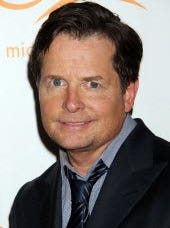 Michael J. Fox at an event in New York City on Nov. 9, 2013. His Michael J. Fox Foundation for Parkinson's Research is teaming with two other groups to better study Parkinson's and Alzheimer's.