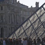 Tourists line up to enter the Louvre museum in Paris, France, May 5, 2016.