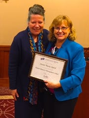Investors Community Bank Executive Vice President and Chief Human Resources Officer Susan Smith (right) is pictured with Terry Saber (left), program coordinator of the Graduate School of Banking's Human Resource Management School