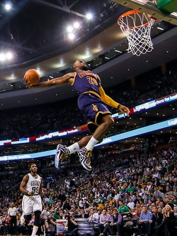 LeBron James dunks against the Celtics during the second