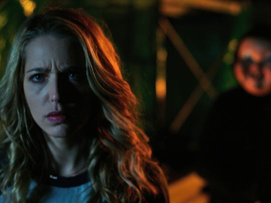 Tree (Jessica Rothe) hears something behind her in