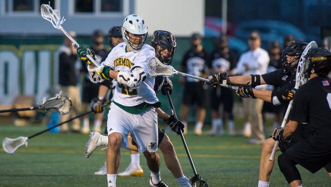 The University of Vermont's Dawes Milchling shoots and scores against UMBC in Burlington on Friday April 27, 2018.