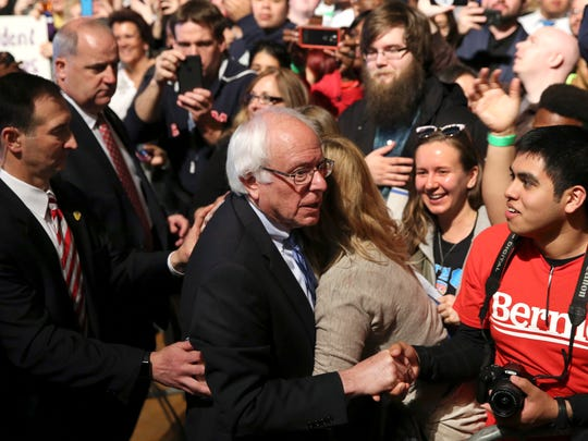 Democratic presidential candidate Sen. Bernie Sanders of Vermont is hugged as he greets supporters at a campaign rally Monday in Atlantic City.