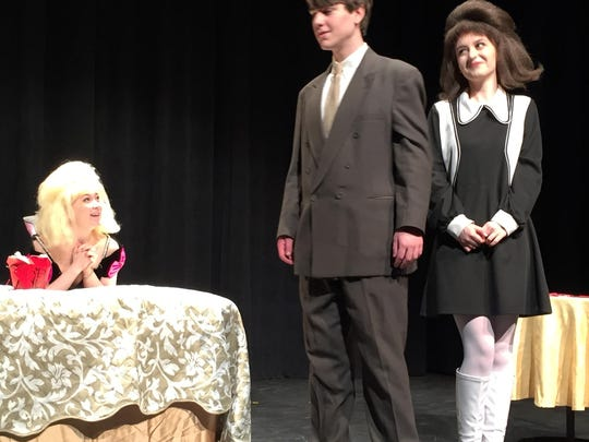 "Maxwell Smart, center, played by Kai Reinsborough, and Agent 99, right, played by Meg Young, have been tasked with protecting the visiting Scandinavian Princess Ingrid, left, played by Mishka Rehak, in Champlain Valley Union's production of ""Get Smart."""