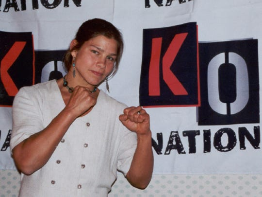Andrea Nelson poses for a photo at a national boxing tournament before she retired and became a boxing coach in Madison, Wisconsin.
