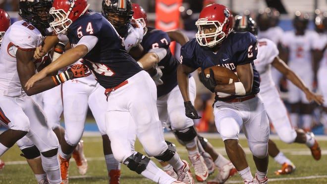 Kendrick Johnson carries the ball during a 24-6 loss to Hoover on Saturday.