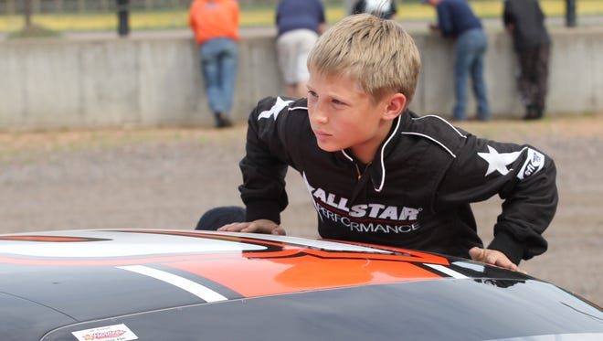 Derek Kraus, shown getting into his stock car before a race at State Park Speedway, will make his debut in the NASCAR Camping World Truck Series on Friday.
