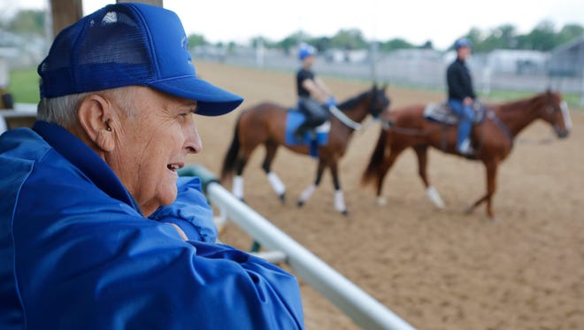 Trainer Forrest Kaelin watches his horses go through their paces at Churchill Downs.