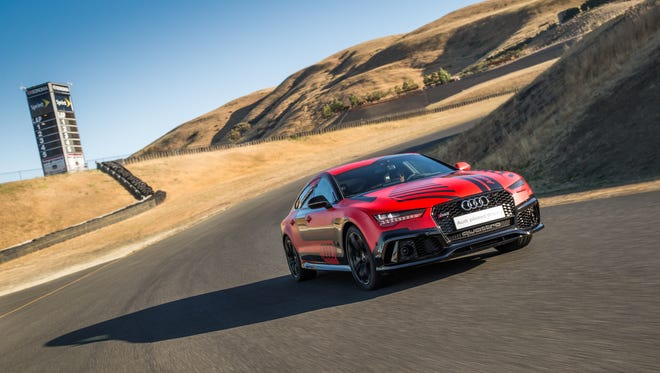 Audi's special RS7, code named Robby, races around the Sonoma Raceway track at pro driver speeds - with no one at the wheel.