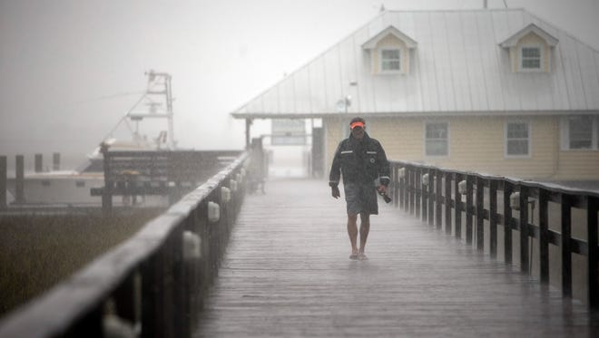 Bull River Yacht Club Dock Master Robert Logan leaves the dock after finishing up storm preparations as Hurricane Matthew makes its way up the East Coast, Friday, Oct. 7, 2016, in Savannah, Ga.  Authorities warned that the danger was far from over, with hundreds of miles of coastline in Florida, Georgia and South Carolina still under threat of torrential rain and dangerous storm surge as the most powerful hurricane to menace the Atlantic Seaboard in over a decade pushed north. (AP Photo/Stephen B. Morton)
