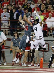 Miami receiver Luke Mayock pulls in a touchdown pass