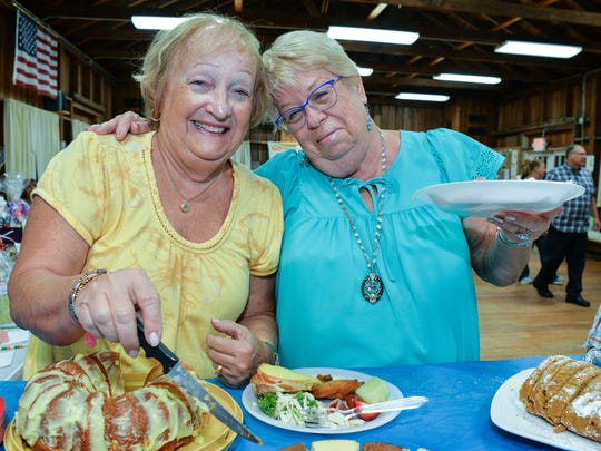 Diane Feeley and Kathy Schuster enjoy some treats at