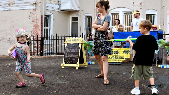 In this file photo, Lorelei Drinkut, 4, of York City, gets sprayed by Liam Leisses, 5, right, of York City, while Drinkut's mother Sarah Noble looks on in the splash zone during First Friday Water Wars on South Duke Street in York, Pa. on Friday, Aug. 7, 2015. (Dawn J. Sagert - dsagert@yorkdispatch.com)