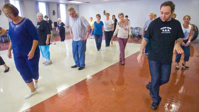 Ira Weisburd, right, teaches seniors line dancing at the Commonwealth Fire Company in Springettsbury Township.