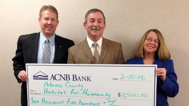 ACNB Bank's contribution was acknowledged with a check presentation. Taking part in the presentation are, from left, James P. Helt, ACNB Bank President; C. L. Pete Ricker, ACNB Bank Senior Vice President of Retail Lending and President and Chairman of the Adams County Habitat for Humanity Board of Directors; and, Cara Lynn Clabaugh, ACNB Bank Vice President/Compliance and Community Reinvestment Act Officer.