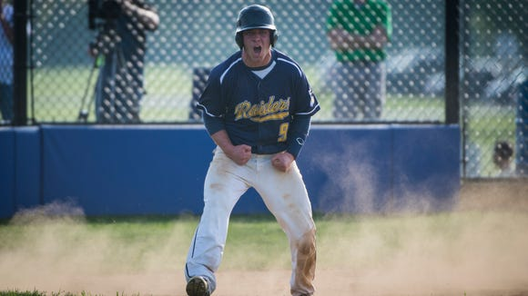 Elco's Travis Zimmerman reacts after scoring during the Raiders' 10-5 win at Cocalico last Thursday.