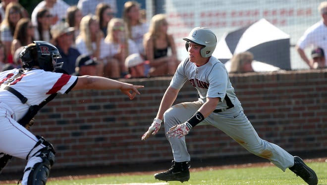 Stewarts Creek's Gresham Mosley (6) gets ready to slide into home as Ravenwood's catcher Jack Kopecky (10) stands at the plate during the 2016 TSSAA Class AAA State Baseball Tournament Tuesday