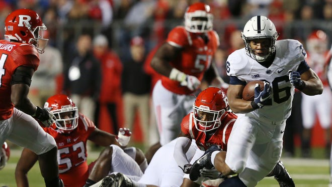 Penn State running back Saquon Barkley (26) runs with the ball during the first half of an NCAA college football game against Rutgers on Saturday, Nov. 19, 2016, in Piscataway, N.J. (AP Photo/Mel Evans)