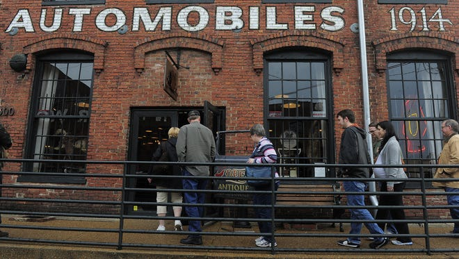 "People line up at the Antiques Archaeology store, which is featured in History Channel's ""American Pickers"" show."