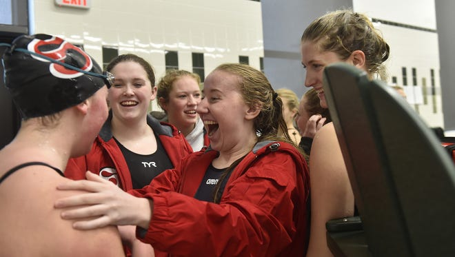 Teammate Katie Peterson congratulates Abi Schauske for winning the 200-yard individual medley Saturday in the Division 2 Ashwaubenon Sectional. Also visible in the photo are, from left, Kaitlyn Schauske, Gale Chier, Peterson and Kailee Moe.