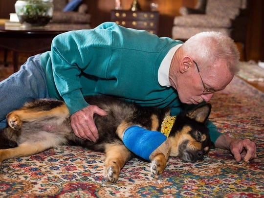 Bill Baker with his rescued pet Marcie.