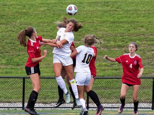 Hartland's Caroline Halonen (18) heads the ball in