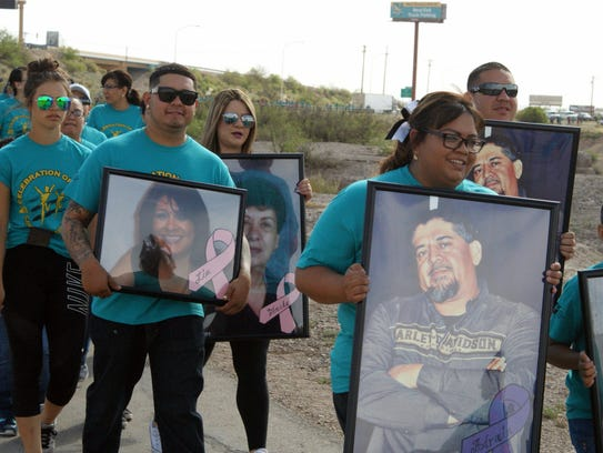 Some walkers carried portraits of loved ones in memory