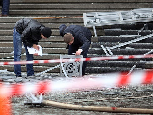 Russian police investigators collect evidence following the suicide bombing.