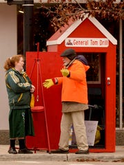 Bell ringer Tom Drill, right, visits with Margret Pauwels of rural Whitelaw during his shift in downtown Manitowoc collecting donations for the Salvation Army's Red Kettle campaign.