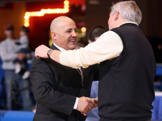 Valhalla coach Dave Greiner, right, shakes hands with