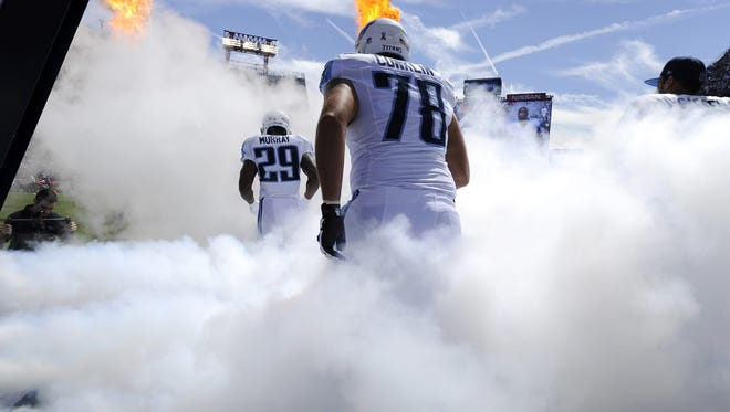 Tennessee Titans offensive tackle Jack Conklin (78) and Titans running back DeMarco Murray (29) enter the field with the team for the home opener against the Vikings at Nissan Stadium Sunday Sept. 11, 2016, in Nashville.