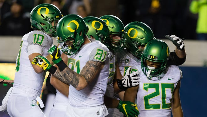 Oct 21, 2016; Berkeley, CA, USA; Oregon Ducks running back Tony Brooks-James (20) is surrounded by teammates after scoring a touchdown against the California Golden Bears during the second quarter at Memorial Stadium. Mandatory Credit: Kelley L Cox-USA TODAY Sports
