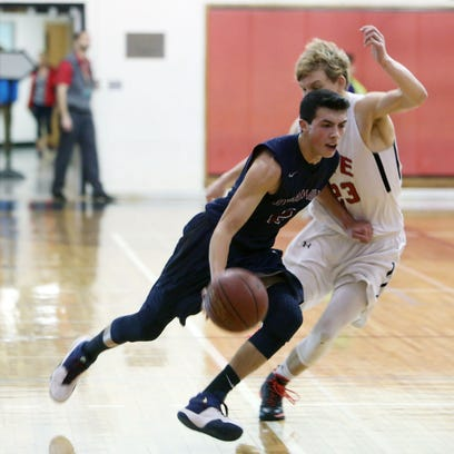 Skylar Sinon drives to the basket against Rye's Charlie