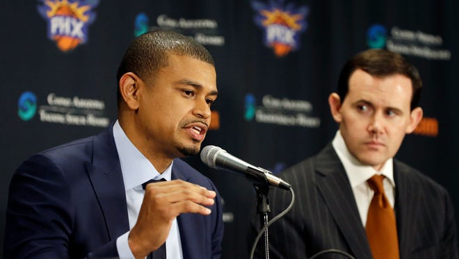 Earl Watson is introduced as the Suns new head coach by Suns General Manager Ryan McDonough (right) during a news conference at Talking Stick Resort Arena in Phoenix, Ariz., on Tuesday, April 19, 2016.
