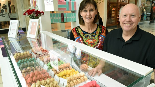Julia and Tommy Maddux at their Woops! macarons kiosk in West Town Mall Monday, April 2, 2018.