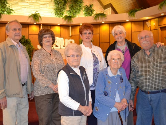 The Rev. Sheryl Seitz, center back row, stands with some of the 50-year members of First United Methodist Church in Clyde who will be recognized on Heritage Sunday on May 21. Pictured are, top row from left, John Fiser, Phyllis Fiser, Seitz, Ruth Cenkus, and Jeff Perry; bottom row from left, Edith Gray and Eilene Perry.
