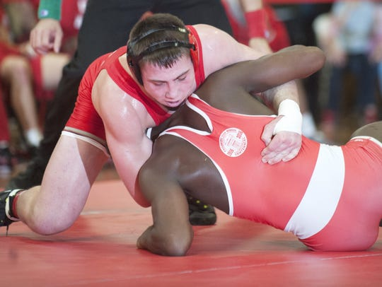 Delsea's Bill Janzer, top, turns Paulsboro's Jamel