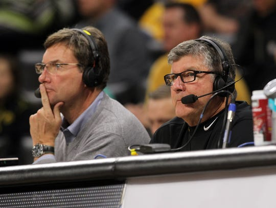 Iowa broadcaster Gary Dolphin (right) was caught ripping the Hawkeyes' basketball team on-air during a timeout on Tuesday.