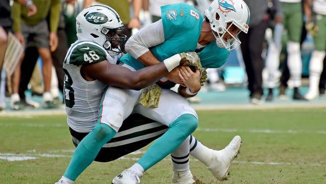 Nov 4, 2018; Miami Gardens, FL, USA; New York Jets outside linebacker Jordan Jenkins (48) sacks Miami Dolphins quarterback Brock Osweiler (8) during the second half at Hard Rock Stadium. Mandatory Credit: Steve Mitchell-USA TODAY Sports