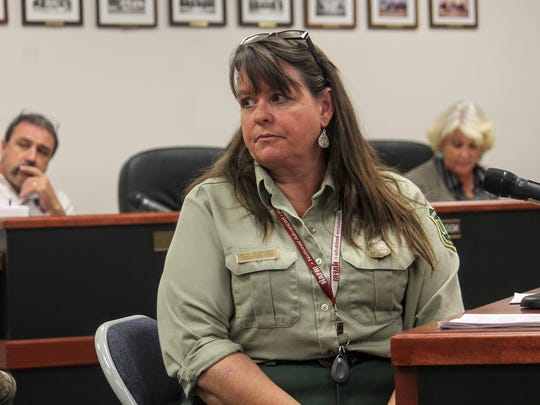Sacramento District Ranger Elizabeth Humphrey listens to resident concerns at a county commission special meeting Monday.