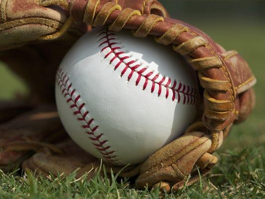 636354075611989133-baseball-glove-grass.jpg